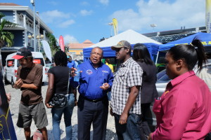 Minister Hylton engaging small business owner at the launch of the Mobile Business Clinic in Montego Bay